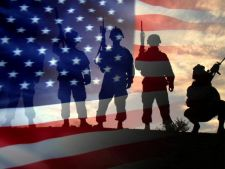 Shadow images of service members in front of the American Flag