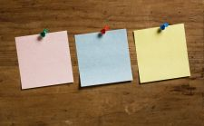 Three blank sticky notes