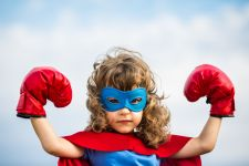 Little girl in superpower costume